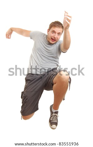 young guy jumping in air, isolated on white