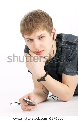young guy listening to music with earphones