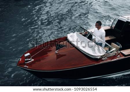 Young guy on a yacht