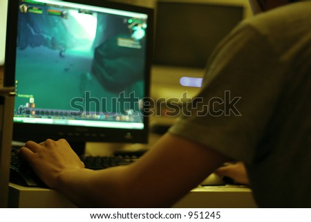 young guy playing computer game