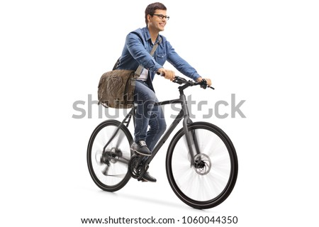 Young guy riding a bicycle isolated on white background