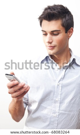 Young guy sending a sms with his mobile phone