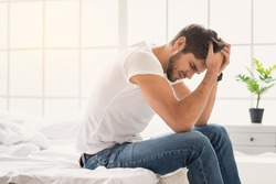 Young guy suffering from headache