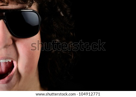 Young Guy Wearing Sunglasses Yelling on black background