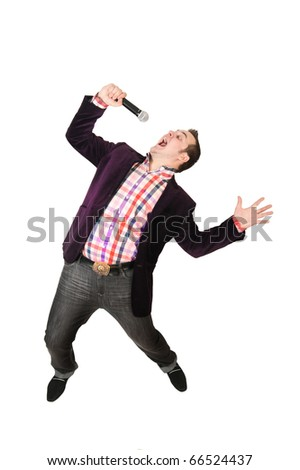Young guy with a microphone over white backrgound - stock photo