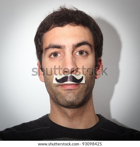 young guy with fake moustaches