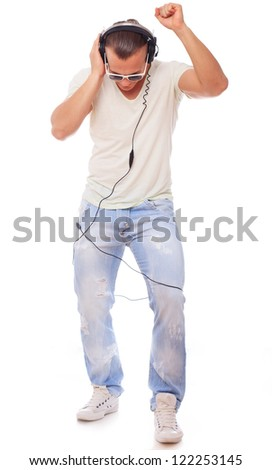 Young guy with headphones and sunglasses dancing