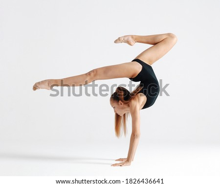 Young gymnast girl stretching and training Stockfoto ©