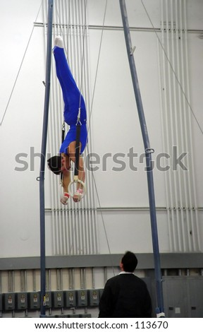 Young gymnast practicing on rings #113670