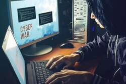 young hacker in the dark breaks the access to steal information and infect computers and systems. concept of hacking and cyber terrorism