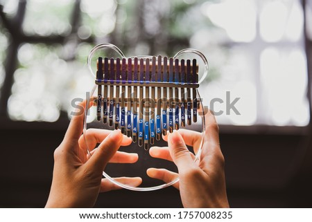 Photo of  Young Hand Playing Mbira Or Kalimba Traditional African Instrument Piano
