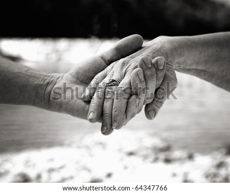 Young hand supporting old hand-helping elderly people concept - Black and White - stock photo