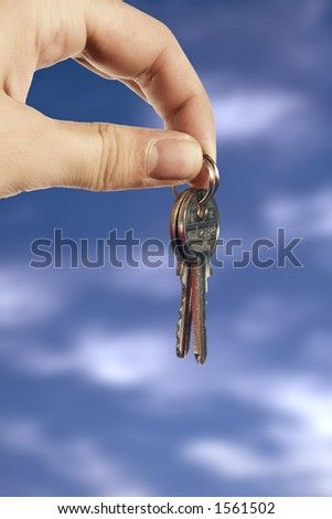 Young hand with keys on clouds background