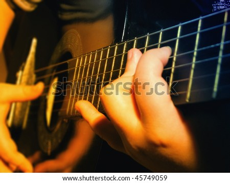 young hands playing guitar