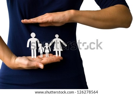 young hands protecting a paper chain family in front of a female body, on white - stock photo