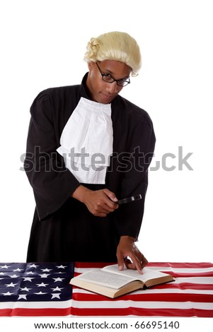 Young handsome african. American judge man reading about justice trough a magnifier. Studio shot. White background.
