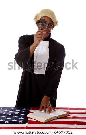Young handsome african. American judge man seeing the justice trough a magnifier. Studio shot. White background.