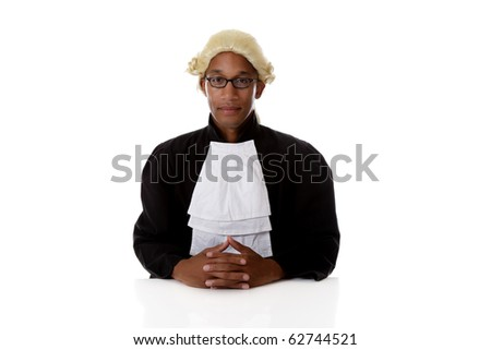 Young handsome African American judge man sitting crossed hands, at his desk. Studio shot. White background.