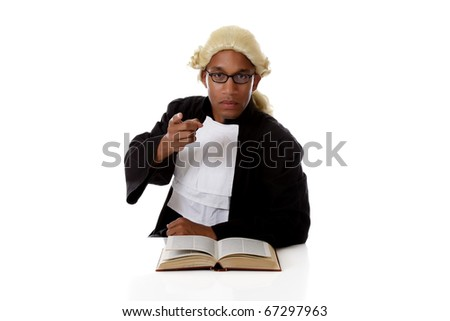 Young handsome African American judge man with a open book on reflective surface, pointing at camera. Studio shot. White background.