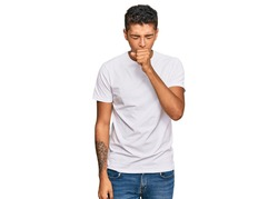 Young handsome african american man wearing casual white tshirt feeling unwell and coughing as symptom for cold or bronchitis. health care concept.