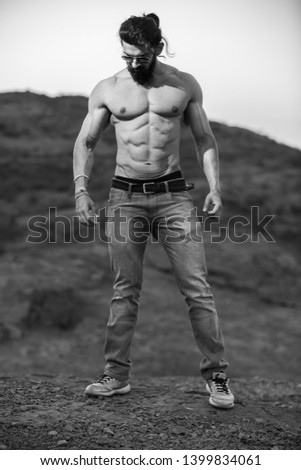 Young handsome Asian muscled fit male model man posing outdoor showing his abdominal muscles black and white - Image