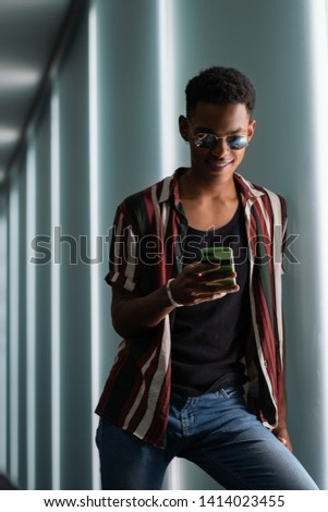 A young man in a casual pose in the city  Images and Stock