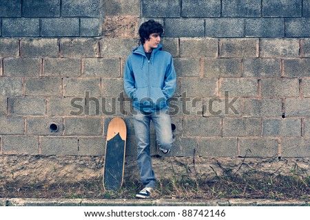 Young handsome boy in urban background