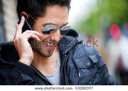 Young handsome boy speaking on phone