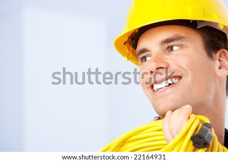 Young handsome builder in yellow uniform. Over white background
