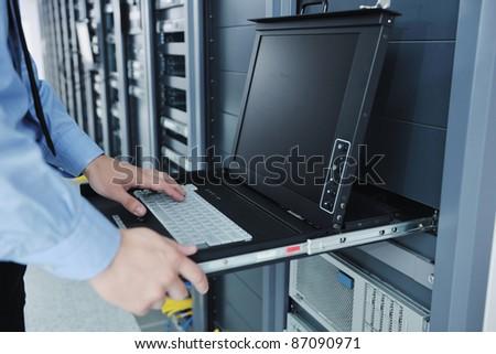 young handsome business man  engineer in datacenter server room