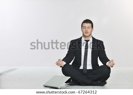 young handsome business man in black suit and tie practice yoga and relax at network server room while representing stres control concept #67264312