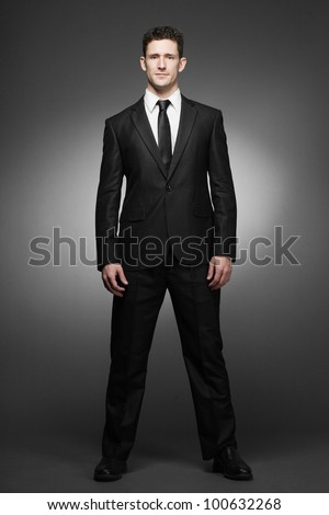Young handsome business man in white shirt and black suit.