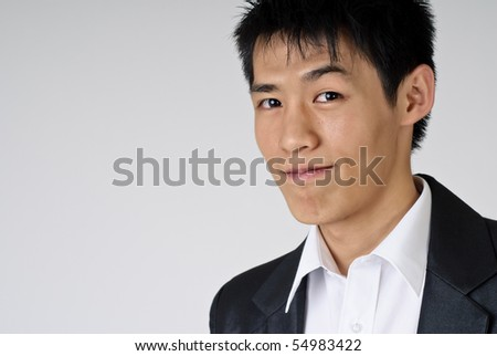 Young handsome business man portrait with smiling expression, closeup.