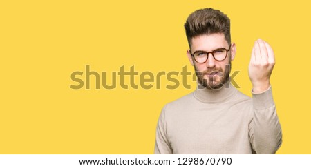 Young handsome business man wearing glasses Doing Italian gesture with hand and fingers confident expression #1298670790