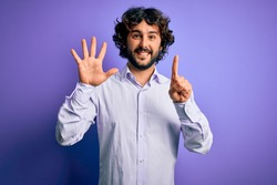 Young handsome business man with beard wearing shirt standing over purple background showing and pointing up with fingers number six while smiling confident and happy.