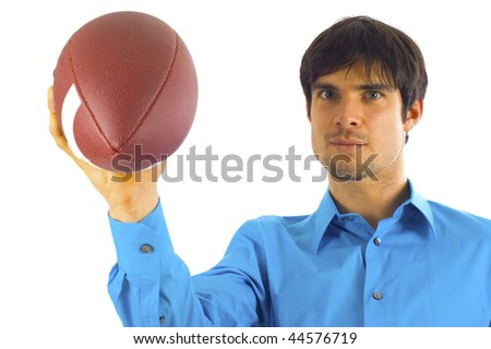 Young handsome businessman holding a football soccer isolated over white background