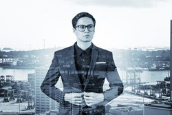 Young handsome businessman in suit and glasses dreaming about new career opportunities after MBA graduation. Singapore on background. Double exposure.