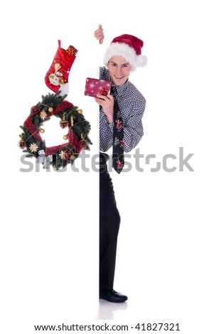 Young handsome businessman  offering a Christmas present. Studio, white background.