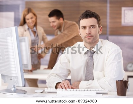 Young handsome businessman sitting at desk at further education training.?