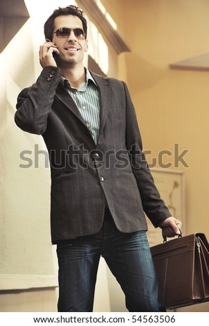 Young handsome businessman talking over cellphone