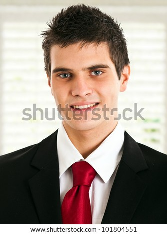 Young handsome businessman with blue eyes portrait