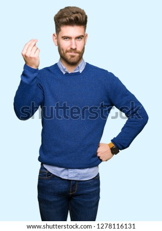 Young handsome bussines man Doing Italian gesture with hand and fingers confident expression #1278116131