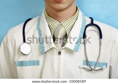 young handsome caucasian doctor with stethoscope (in focus)