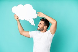 Young handsome caucasian man isolated on blue background holding a thinking speech bubble