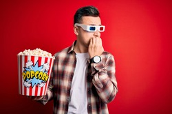 Young handsome caucasian man wearing 3d movie glasses and eating popcorn looking stressed and nervous with hands on mouth biting nails. Anxiety problem.