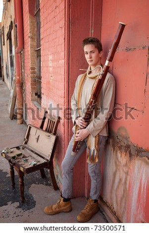 Young handsome Caucasian man with Bassoon in his hands