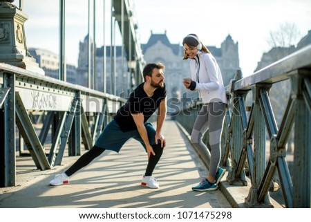 Young handsome couple have training in urban enviroment at sunny day
