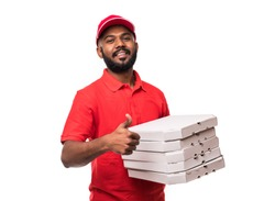 Young handsome delivery man showing pizza box and holding thumb up sign isolated on white background