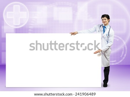 Young handsome doctor with white blank banner. Place your text