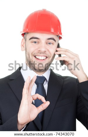 Young handsome Engineer got good news on cell phone, doing OK sign